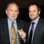 From left: Larry Brilliant and Jeff Skoll accept the Public Health Champion award from the UCLA Fielding School of Public Health   (Photo Courtesy of the Skoll Foundation)