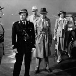 "Captain Renault (Claude Rains, in black): ""Round up the usual suspects."" (Photo: From Casablanca, 1942, Warner Bros. Pictures)"