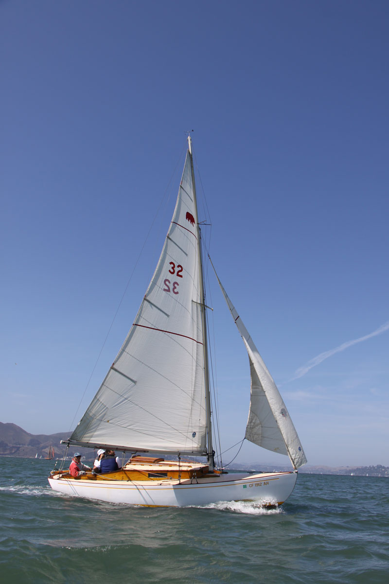 Joe Bambara and crew aboard #32 Little Dipper, with the Bear fleet's eponymous logo on sail    photo: Ellen hoke