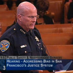 Chief Suhr appears before the Board of Supervisors Public Safety Committee to discuss racist and homophobic messages shared by his officers.        photo: San Francisco Govtv