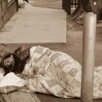 A homeless man sleeps in a San Francisco parking lot.    photo: Franco Folini