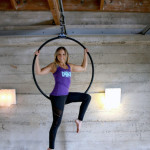 Karrie Becker, Crunch group fitness instructor with the hoop used in the aerial fitness classes she teaches.    photo: courtesy crunch