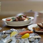 Oysters, eggplant Parmigiana, and toasted raviolis.    photos: spaghetti bros. / sloane morrison