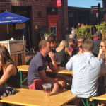 Visitors enjoy the pop-up beer garden with live music in Ghirardelli Square.  photos: Kennet Majerowicz