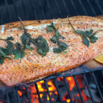 Cedar-planked salmon on a charcoal grill. photo: dreamstime.com