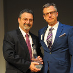 Zephyr President Randall Kostick (left) accepts his firm's Brokerage of the Year award from Alf Nucifora, chairman and founder of The Luxury Marketing Council of San Francisco. Courtesy Zephyr Real Estate