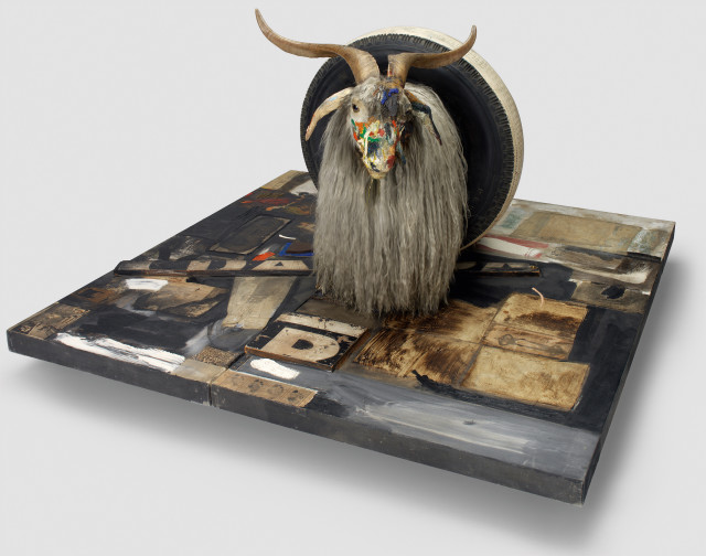 Robert Rauschenberg, Monogram, 1955–59; oil, paper, fabric, printed paper, printed reproductions, metal, wood, rubber shoe heel, and tennis ball on canvas with oil and rubber tire on Angora goat on wood platform mounted on four casters. Image: Moderna Museet, Stockholm, purchase 1965 with contribution from Moderna Museets Vänner/The Friends of Moderna Museet;© Robert Rauschenberg Foundation