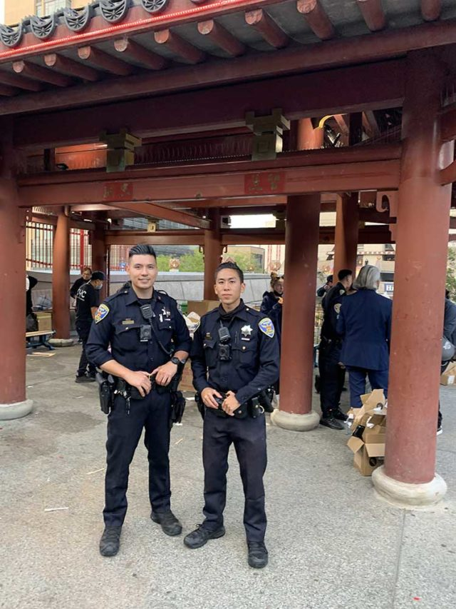 SFPD Officers William Ma (left) and Loren Chiu (right) at the 2021 Chinatown Night Out event held at Portsmouth Square, Photo: Anh L�